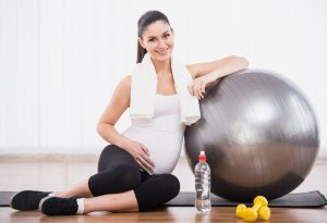 Woman sitting with ball