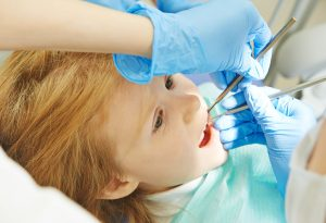 A little girl at a dental clinic