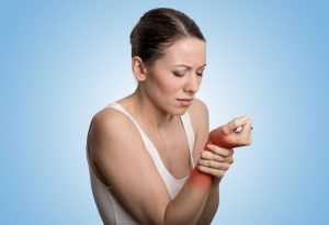 A woman holding her wrist in pain