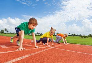 <Kids racing on field