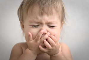 An unwell baby crying due to discomfort
