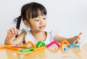 A girl playing with playdough