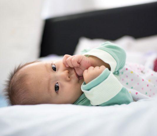 Baby girl sucking her thumb