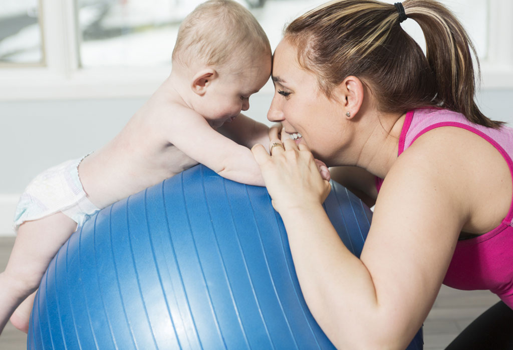 Mother and baby with pilates ball