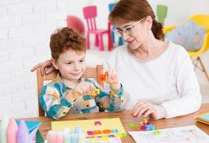 A teacher helping a child