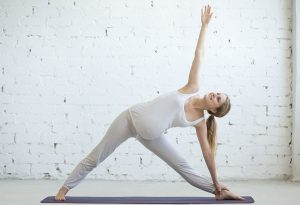Extended triangle pose for a backache during pregnancy