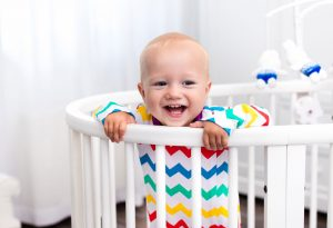 Baby laughing in the crib