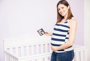 Woman standing next to crib