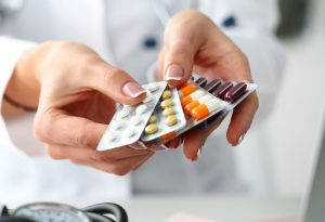 Doctor offering different types of contraceptive pills