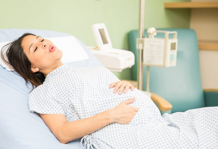 A pregnant woman trying to breath