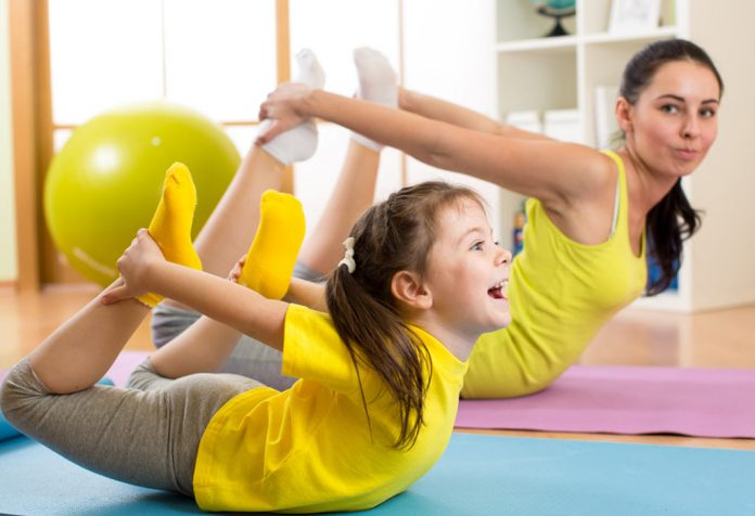 A mother and daughter doing yoga