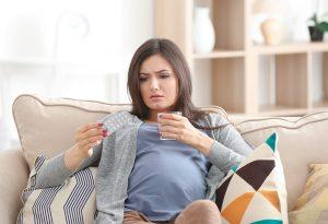 Woman taking vitamin pills