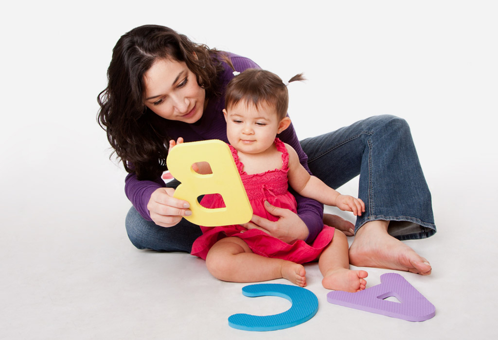 Mother and baby playing with alphabets
