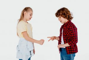 Kids playing rock paper scissors