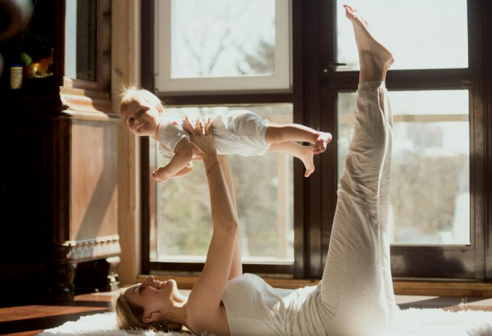Mother exercising with her baby