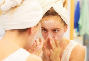 Woman applying face mask