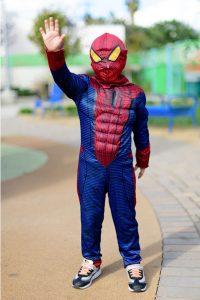 A little boy dressed as Spiderman