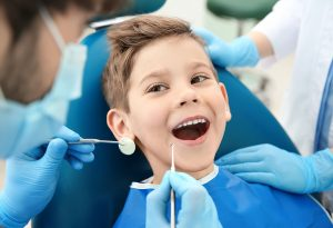 Dentist examining child's teeth
