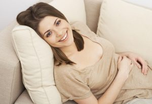 pregnant woman on a sofa