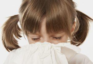 Little girl using a handkerchief