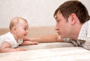 Baby talking to dad