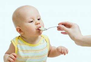 Feeding a baby with a spoon