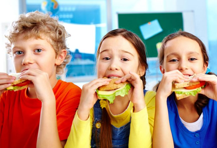 Children eating sandwiches