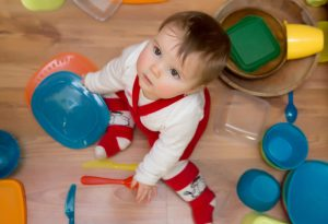 Baby playing with utensils