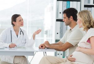 Couple getting counseling from gynaecologist