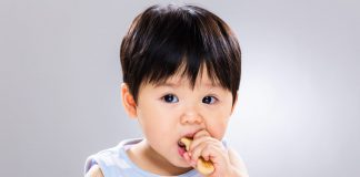 A little boy eating a cookie
