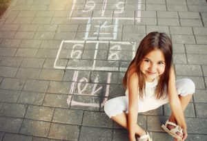 A girl playing hopscotch