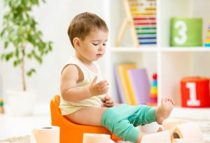 11-month-old baby sitting on potty