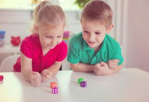 Kids playing with dice