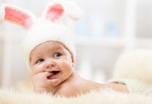 Image of Baby Smiling with Bunny Hat