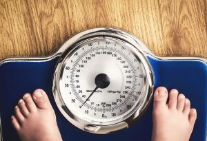 A child standing on a weighing scale