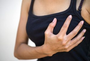 A woman experiencing breast pain