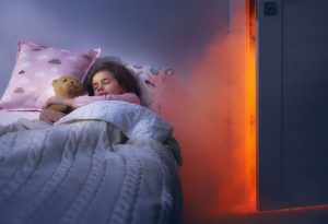 A girl sleeping with a cuddly toy