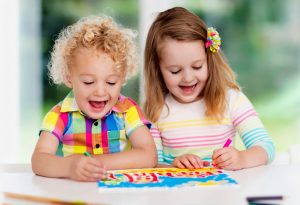 Two kids painting