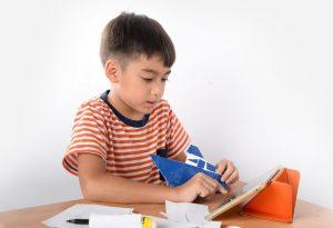A boy folding paper