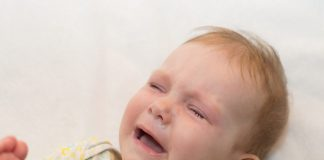 Sick baby crying