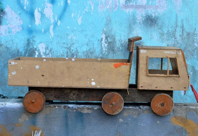 A wooden toy car
