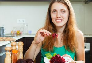 A woman eating beetroot