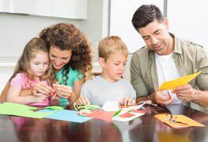 Family doing paper art