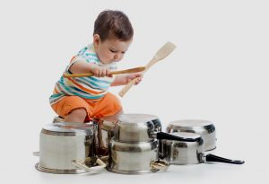 A child drumming on pans and pots