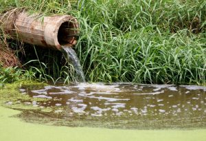 Polluted water running from a concrete pipeline