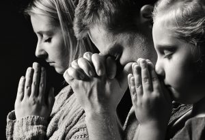 Family praying together - Respecting Religion