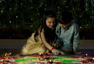 Kids making rangoli