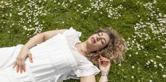 A young woman lying in the field