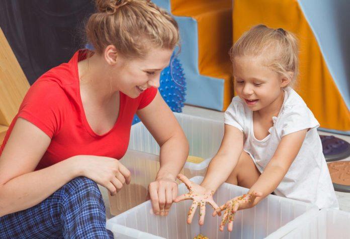 A girl trying sensory activity