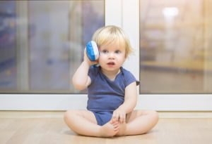 1-year-old baby on toy-phone